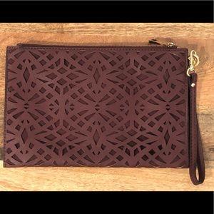 Aldo burgundy cutout flat zip clutch purse bag